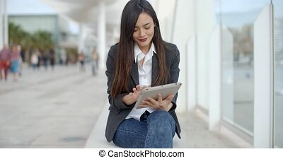 Stylish young woman using her tablet-pc