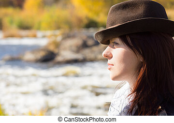 Stylish young woman wearing a hat