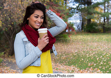 Stylish young woman with coffee ou