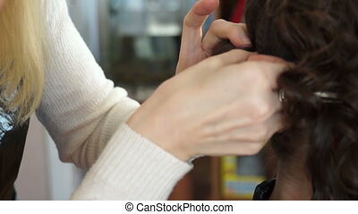Stylist butchering the hair of the model hairpins