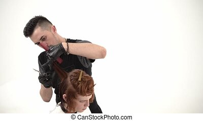 Stylist Hairdresser Makes a Stylish Hairstyle Young Guy with...