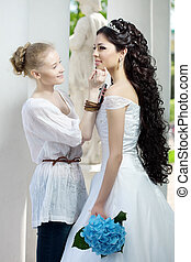 Stylist takes care of the bride - Image of the stylist takes...