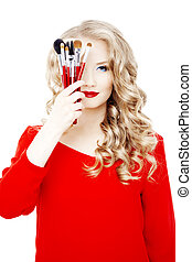 Stylist with make up brushes - Professional stylist with...