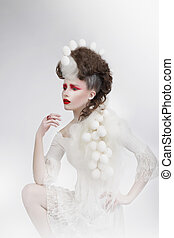 Stylization. Woman with Eggshells and Art Fancy Makeup. Fantasy