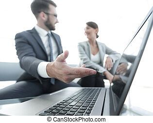 business colleagues working with laptop