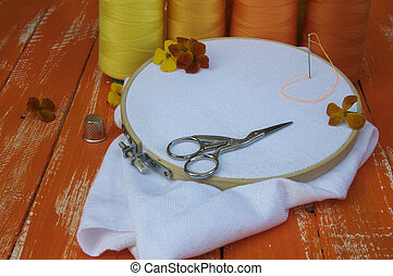 stylized photo in the orange range of items for sewing and embroidery