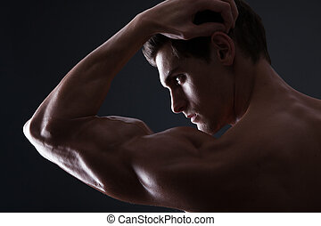 stylized, retrato, de, muscular, homem flexiona, bicep
