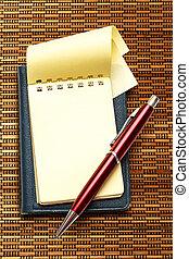stylo, bloc-notes, jaune rouge, vide