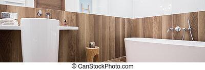 Stylsih bathtub and washbasin - Panorama of stylish bathtub...