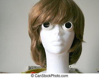 Styrofoam head with wig and goggles
