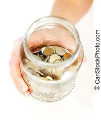 su, monete, vaso, isolato, vetro, mano, fondo., tenere, bianco, tavola.