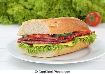 Sub sandwich baguette on plate with salami ham for breakfast