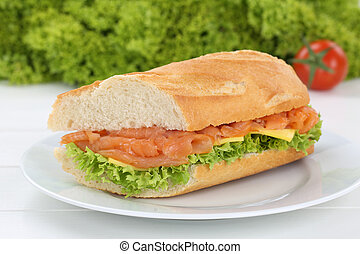 Sub sandwich baguette on plate with salmon fish for breakfast