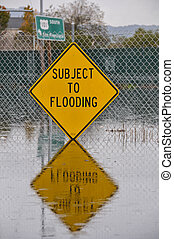 Subject to flooding sign and reflection