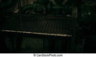 submarine hatchway, upward movement of the ladder inside...