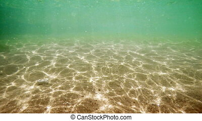 Submarine Perspective of Sunshine Dappling Shallow, Sandy...