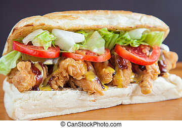 Submarine sandwich fried chicken closeup