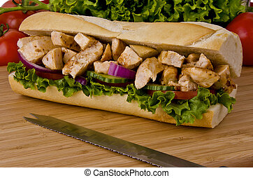 Submarine sandwich - Sub sandwich on a cutting board. ...