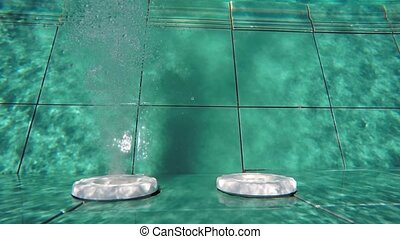 Submerged Perspective of Water Jets in a Swimming Pool -...