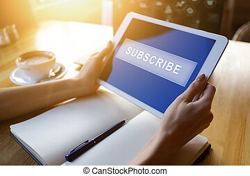 Subscribe button on device screen. Internet and digital marketing concept