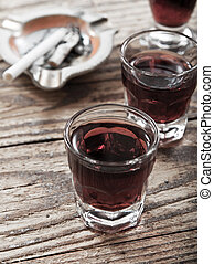 Substance abuse - A shot glass full of alcohol and cigarette...
