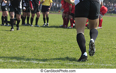 Substitution - Abstract image of a team game (rugby) moment-...