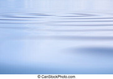 Subtle Water Ripples - A blue water surface background with...