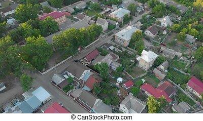Suburb Drone Surveillance aerial bird eye view village street private houses