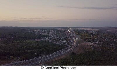 Suburb road aerial - Countryland road suburb town evening...