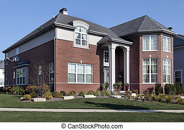 Suburban brick home with columns