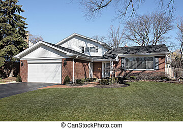 Suburban brick home with orange walkway