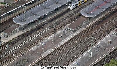 suburban electric train approaches a railway platform....