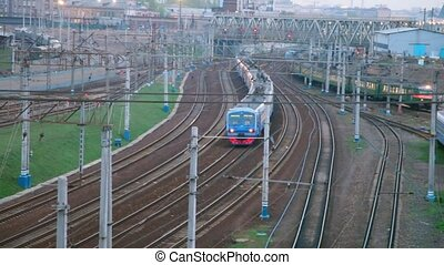 suburban electric trains moving on railway lines near station
