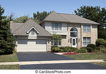 Suburban home with arched window - Front view of suburban...