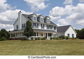 Suburban home with blue shutters and wraparound porch