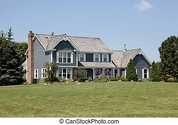 Suburban home with blue siding