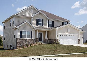 Suburban home with stonework