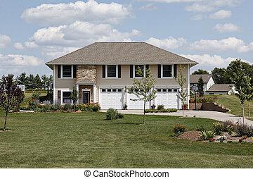 Suburban home with three car garage