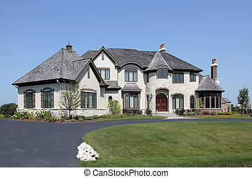 Suburban home with turret - Large suburban white home with...