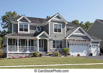 Suburban home with wraparound porch and columns