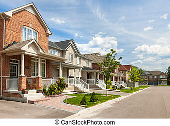 Suburban homes - Suburban residential street with red brick...