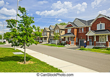 Suburban homes - Suburban residential street with red brick ...