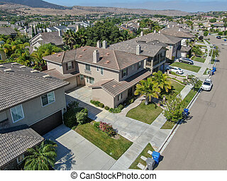 Suburban neighborhood street with big villas
