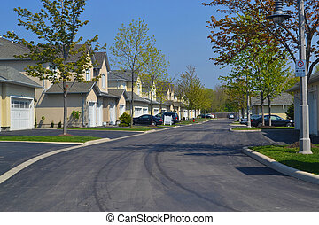 A pretty and quiet suburban neighbourhood in the early spring, on a beautiful sunny day.