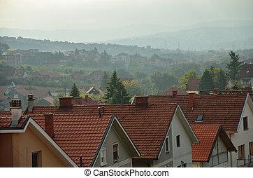 Suburban panorama in morning mist