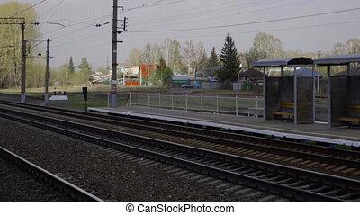 Suburban railway station - Before suburban train arriving at...