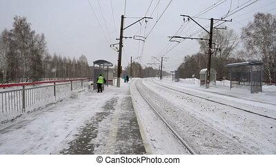 Suburban railway station, snowstorm Novosibirsk region