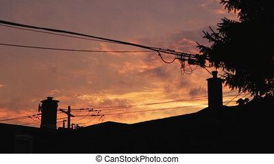 Suburban sunset. Timelapse.