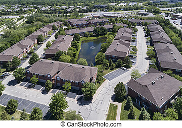 Suburban Townhouse Neighborhood Aerial with Pond