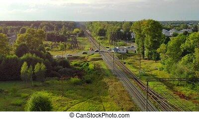 Suburban Traffic over Railroad Crossing in Russia - Aerial ...